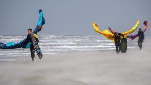 riders on a kitesurf wind storm